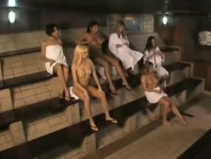 Group of lesbians playing in a sauna