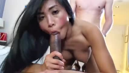Asian girl taking a black and white dick at the same time