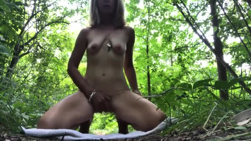 Mature woman masturbates outside